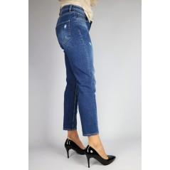 Niebieskie spodnie jeansowe damskie z delikatnymi przetarciami