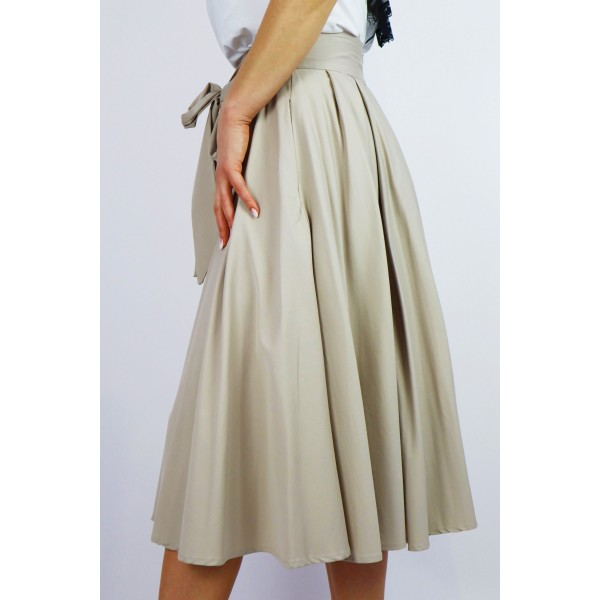 Beżowa spódnica damska midi z kloszowaniami