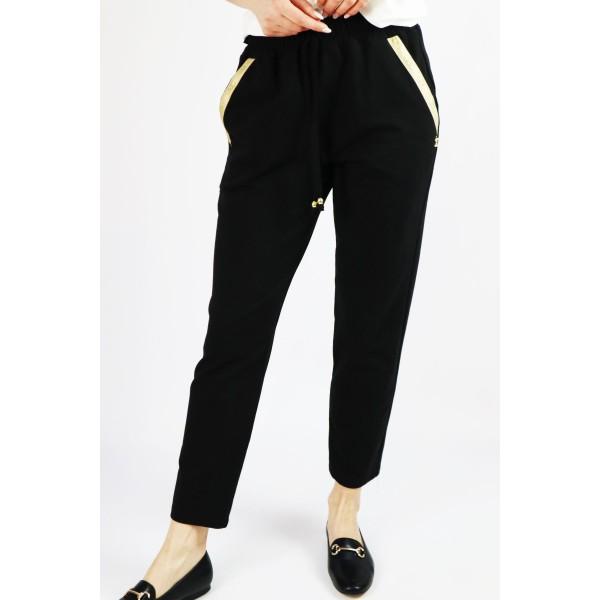 Czarne damskie spodnie dresowe ze złotą lamówką przy kieszeniach